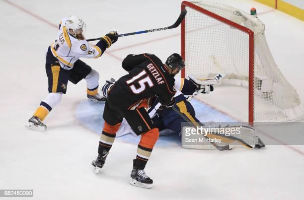 Ryan Getzlaf of the Anaheim Ducks can't put the puck under the leg pad of goaltender Pekka Rinne of the Nashville Predators as Ryan Ellis of the...