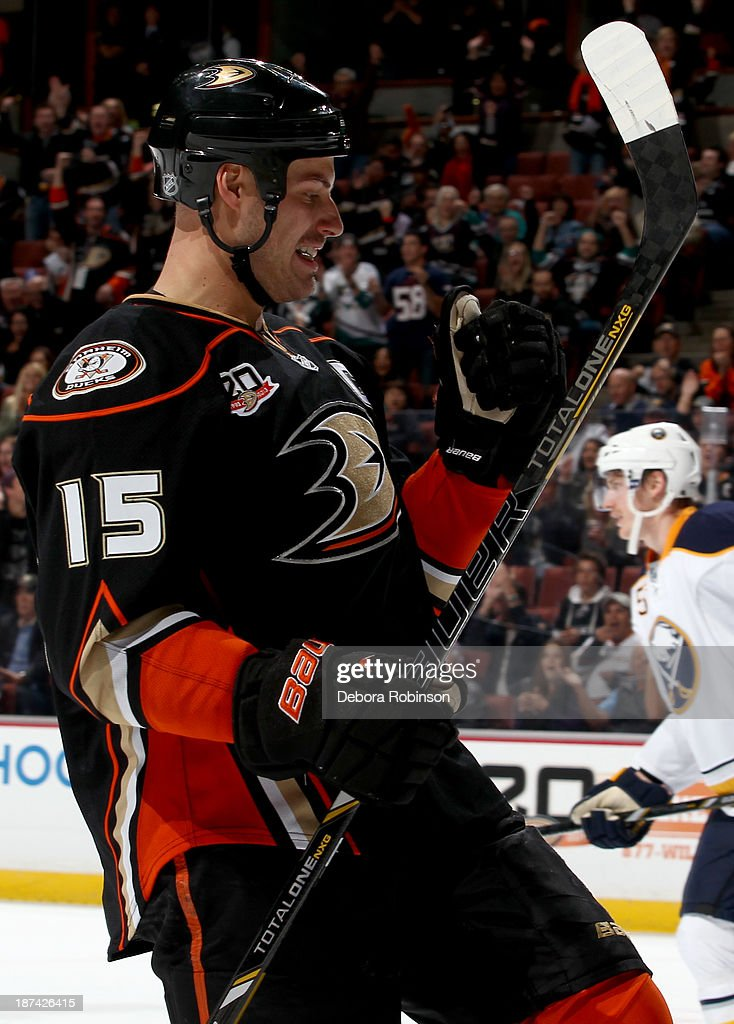 Ryan Getzlaf #15 of the Anaheim Ducks celebrates his first career hat trick during a game against the Buffalo Sabres at Honda Center on November 8, 2013 in Anaheim, California.