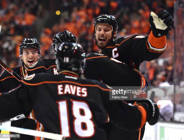 Ryan Getzlaf of the Anaheim Ducks celebrates his goal with Shea Theodore and Patrick Eaves to take a 10 lead over the Calgary Flames during the first...