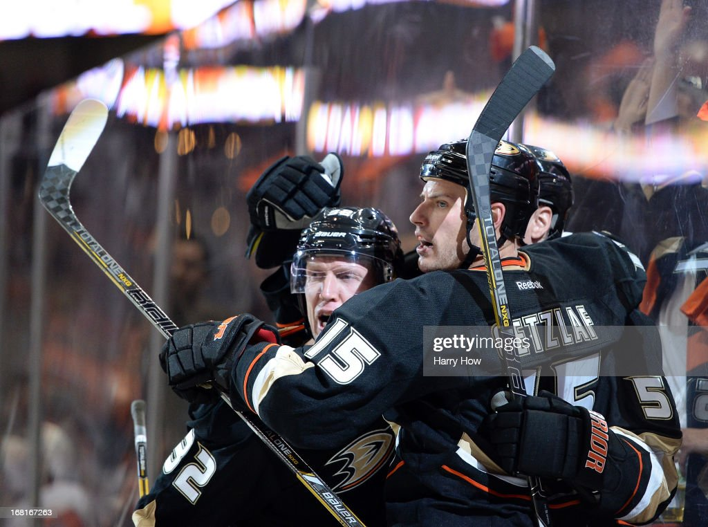 Ryan Getzlaf #15 of the Anaheim Ducks celebrates his goal with Toni Lydman #32 and Kyle Palmieri #51 to trail 4-2 during the third period in Game Two of the Western Conference Quarterfinals during the 2013 Stanley Cup Playoffs at Honda Center on May 2, 2013 in Anaheim, California.