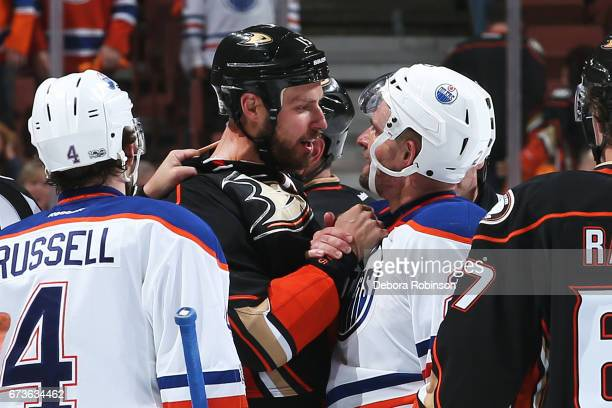 Ryan Getzlaf of the Anaheim Ducks chats with Andrej Sekera of the Edmonton Oilers after a whistle in Game One of the Western Conference Second Round...
