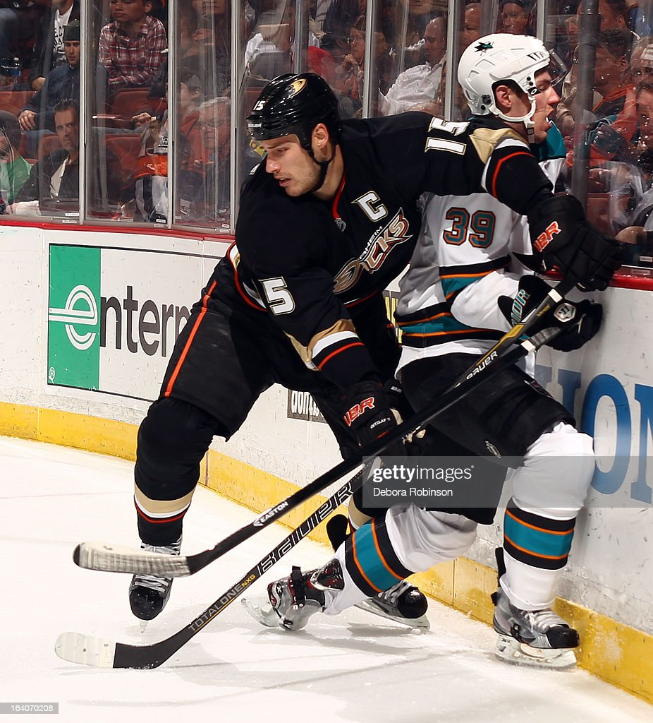 <a gi-track='captionPersonalityLinkClicked' href=/galleries/search?phrase=Ryan+Getzlaf&family=editorial&specificpeople=602655 ng-click='$event.stopPropagation()'>Ryan Getzlaf</a> #15 of the Anaheim Ducks checks <a gi-track='captionPersonalityLinkClicked' href=/galleries/search?phrase=Logan+Couture&family=editorial&specificpeople=809700 ng-click='$event.stopPropagation()'>Logan Couture</a> #39 of the San Jose Sharks into the boards during the game on March 18, 2013 at Honda Center in Anaheim, California.