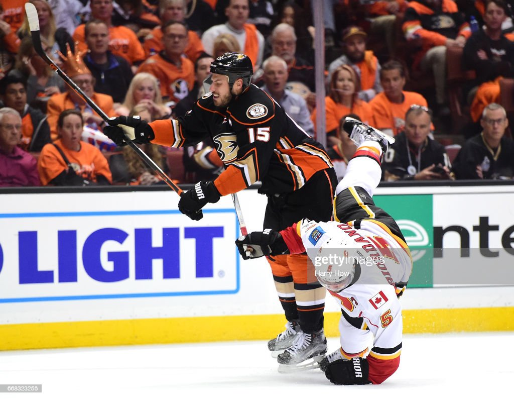 Ryan Getzlaf #15 of the Anaheim Ducks checks Mark Giordano #5 to the ice during a 3-2 Ducks win in Game One of the Western Conference First Round during the 2017 NHL Stanley Cup Playoffs at Honda Center on April 13, 2017 in Anaheim, California.