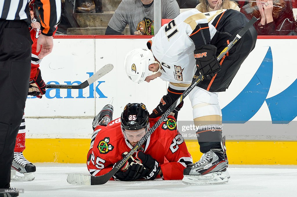 <a gi-track='captionPersonalityLinkClicked' href=/galleries/search?phrase=Ryan+Getzlaf&family=editorial&specificpeople=602655 ng-click='$event.stopPropagation()'>Ryan Getzlaf</a> #15 of the Anaheim Ducks checks on <a gi-track='captionPersonalityLinkClicked' href=/galleries/search?phrase=Viktor+Stalberg&family=editorial&specificpeople=5802237 ng-click='$event.stopPropagation()'>Viktor Stalberg</a> #25 of the Chicago Blackhawks after Stalberg got hit in the face with a puck during the NHL game on March 29, 2013 at the United Center in Chicago, Illinois.