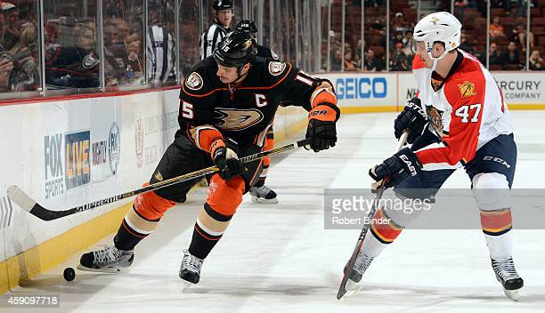 Ryan Getzlaf of the Anaheim Ducks controls the puck with Colby Robak of the Florida Panthers defending on November 16 2014 at Honda Center in Anaheim...