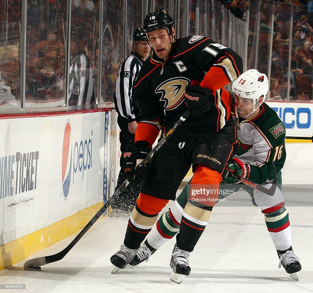 Ryan Getzlaf #15 of the Anaheim Ducks handles the puck against Jason Zucker #16 of the Minnesota Wild on March 1, 2013 at Honda Center in Anaheim, California.