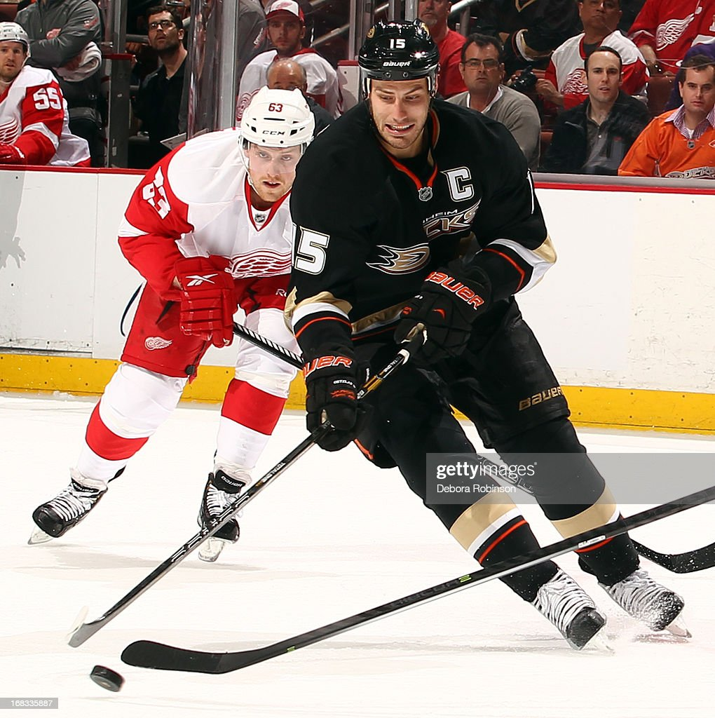 Ryan Getzlaf #15 of the Anaheim Ducks handles the puck against Joakim Andersson #63 of the Detroit Red Wings in Game Five of the Western Conference Quarterfinals during the 2013 NHL Stanley Cup Playoffs at Honda Center on May 8, 2013 in Anaheim, California.