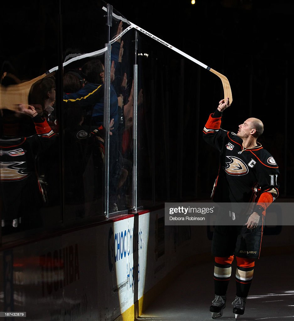 <a gi-track='captionPersonalityLinkClicked' href=/galleries/search?phrase=Ryan+Getzlaf&family=editorial&specificpeople=602655 ng-click='$event.stopPropagation()'>Ryan Getzlaf</a> #15 of the Anaheim Ducks hands his stick to a fan after a victory against the Buffalo Sabres at Honda Center on November 8, 2013 in Anaheim, California.