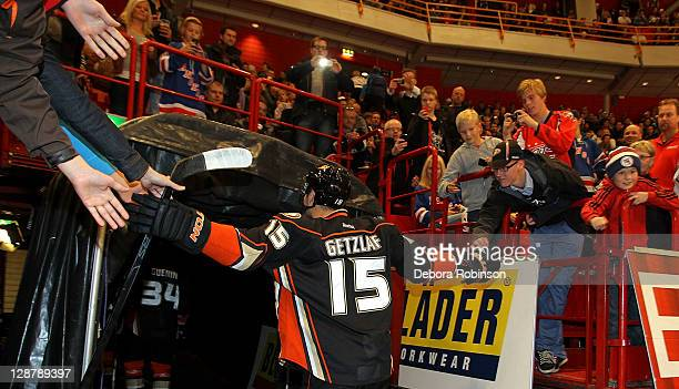 Ryan Getzlaf of the Anaheim Ducks high fives fans after pregame warm ups against the New York Rangers on October 8 2011 at the Globe Arena during the...