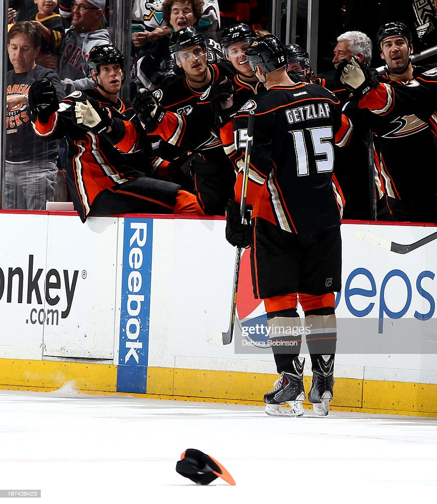 <a gi-track='captionPersonalityLinkClicked' href=/galleries/search?phrase=Ryan+Getzlaf&family=editorial&specificpeople=602655 ng-click='$event.stopPropagation()'>Ryan Getzlaf</a> #15 of the Anaheim Ducks high fives teammates after scoring a goal during a game against the Buffalo Sabres at Honda Center on November 8, 2013 in Anaheim, California.