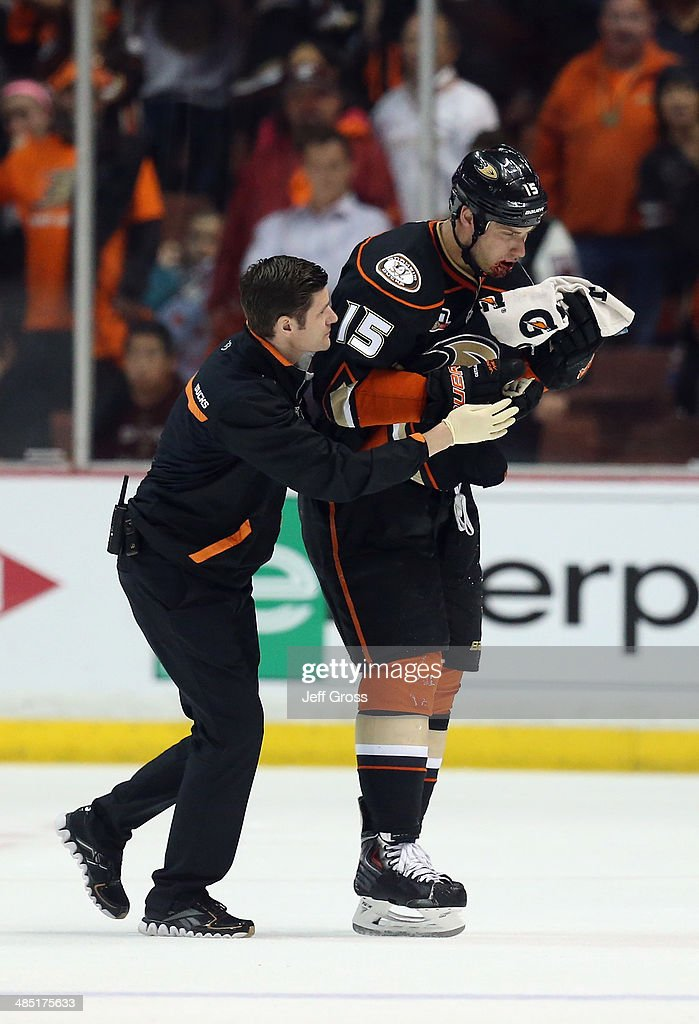 <a gi-track='captionPersonalityLinkClicked' href=/galleries/search?phrase=Ryan+Getzlaf&family=editorial&specificpeople=602655 ng-click='$event.stopPropagation()'>Ryan Getzlaf</a> #15 of the Anaheim Ducks is attended to by a member of the medical staff after being hit in the face with a puck late in the third period against the Dallas Stars in Game One of the First Round of the 2014 NHL Stanley Cup Playoffs at Honda Center on April 16, 2014 in Anaheim, California. The Ducks defeated the Stars 4-3.