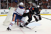 Ryan Getzlaf of the Anaheim Ducks is checked off the puck by Jeff Petry of the Edmonton Oilers in the third period at Honda Center on January 3 2014...
