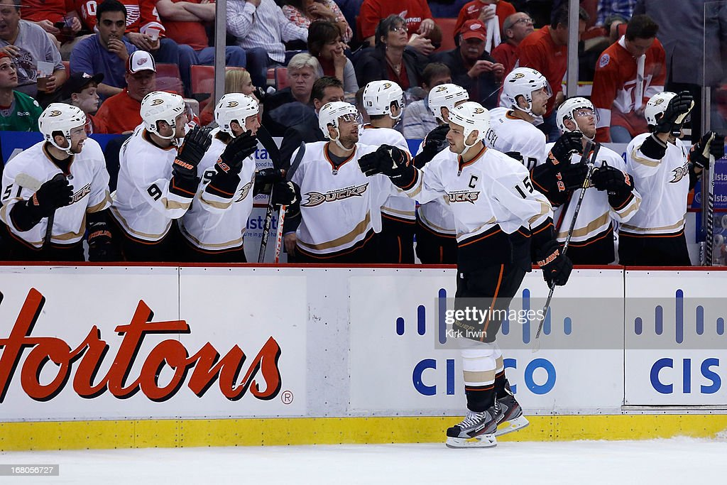 <a gi-track='captionPersonalityLinkClicked' href=/galleries/search?phrase=Ryan+Getzlaf&family=editorial&specificpeople=602655 ng-click='$event.stopPropagation()'>Ryan Getzlaf</a> #15 of the Anaheim Ducks is congratulated by his teammates after scoring a goal against the Detroit Red Wings during the third period of Game Three of the Western Conference Quarterfinals during the 2013 NHL Stanley Cup Playoffs on May 4, 2013 at Joe Lewis Arena in Detroit, Michigan. Anaheim defeated Detroit 4-0 to take a 2-1 series lead.