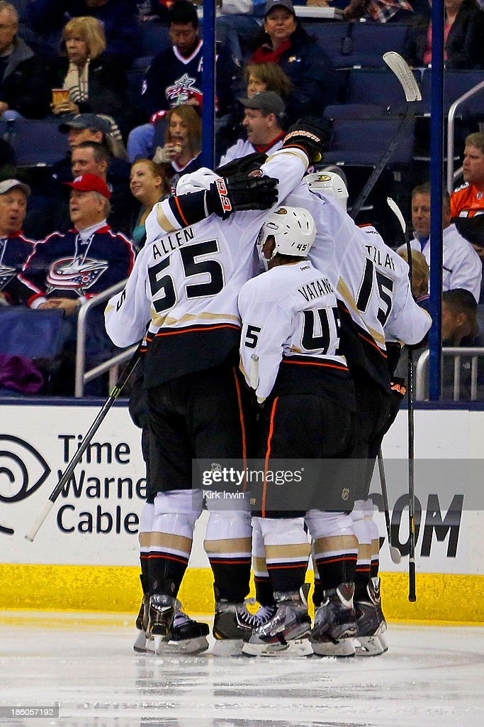Ryan Getzlaf #15 of the Anaheim Ducks is congratulated by his teammates after scoring a goal against the Columbus Blue Jackets during the second period on October 27, 2013 at Nationwide Arena in Columbus, Ohio.