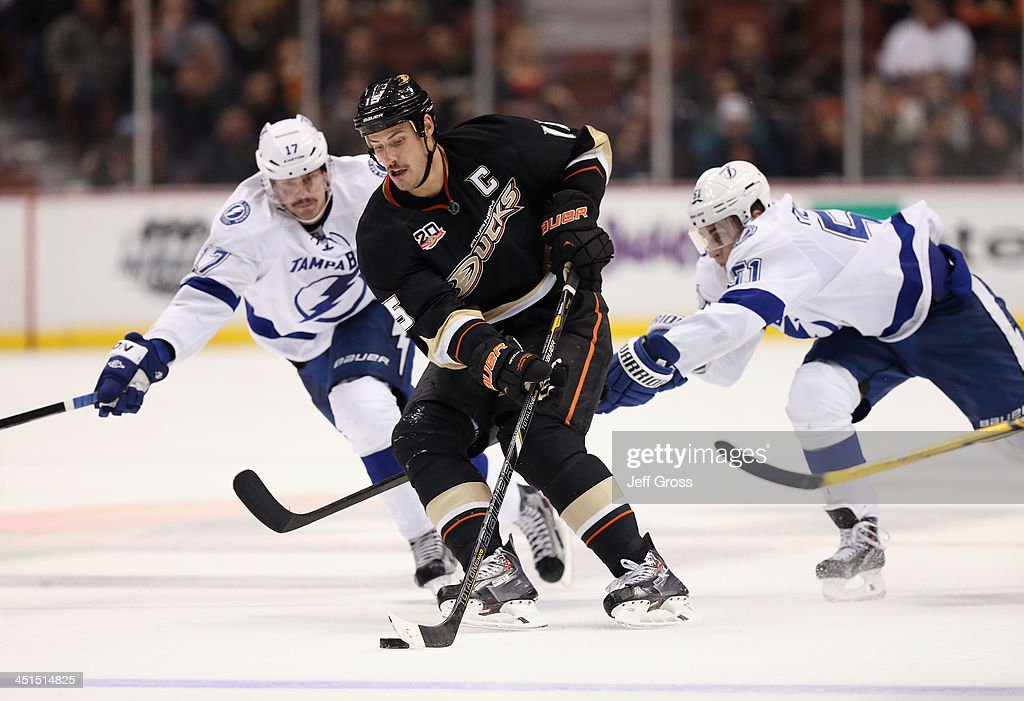 <a gi-track='captionPersonalityLinkClicked' href=/galleries/search?phrase=Ryan+Getzlaf&family=editorial&specificpeople=602655 ng-click='$event.stopPropagation()'>Ryan Getzlaf</a> #15 of the Anaheim Ducks is pursued by Alex Killorn (L) #17 and <a gi-track='captionPersonalityLinkClicked' href=/galleries/search?phrase=Valtteri+Filppula&family=editorial&specificpeople=2234404 ng-click='$event.stopPropagation()'>Valtteri Filppula</a> #51 of the Tampa Bay Lightning in the third period at Honda Center on November 22, 2013 in Anaheim, California. The Ducks defeated the Lightning 1-0 in overtime.