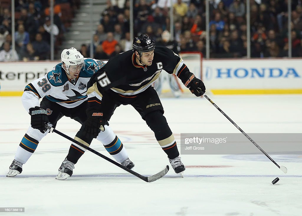 <a gi-track='captionPersonalityLinkClicked' href=/galleries/search?phrase=Ryan+Getzlaf&family=editorial&specificpeople=602655 ng-click='$event.stopPropagation()'>Ryan Getzlaf</a> #15 of the Anaheim Ducks is pursued by <a gi-track='captionPersonalityLinkClicked' href=/galleries/search?phrase=Logan+Couture&family=editorial&specificpeople=809700 ng-click='$event.stopPropagation()'>Logan Couture</a> #39 of the San Jose Sharks for the puck in the third period at Honda Center on February 4, 2013 in Anaheim, California. The Ducks defeated the Sharks 2-1.