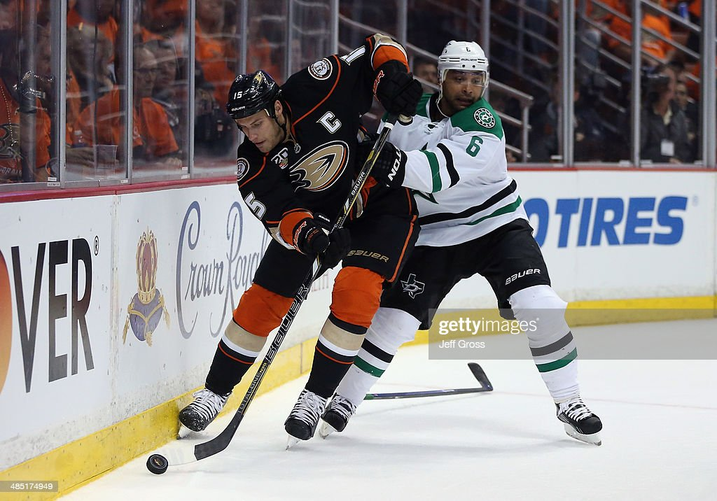 <a gi-track='captionPersonalityLinkClicked' href=/galleries/search?phrase=Ryan+Getzlaf&family=editorial&specificpeople=602655 ng-click='$event.stopPropagation()'>Ryan Getzlaf</a> #15 of the Anaheim Ducks is pursued by <a gi-track='captionPersonalityLinkClicked' href=/galleries/search?phrase=Trevor+Daley&family=editorial&specificpeople=213975 ng-click='$event.stopPropagation()'>Trevor Daley</a> #6 of the Dallas Stars for the puck in the first period of Game One of the First Round of the 2014 NHL Stanley Cup Playoffs at Honda Center on April 16, 2014 in Anaheim, California. The Ducks defeated the Stars 4-3.