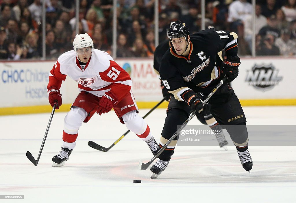 <a gi-track='captionPersonalityLinkClicked' href=/galleries/search?phrase=Ryan+Getzlaf&family=editorial&specificpeople=602655 ng-click='$event.stopPropagation()'>Ryan Getzlaf</a> #15 of the Anaheim Ducks is pursued by <a gi-track='captionPersonalityLinkClicked' href=/galleries/search?phrase=Valtteri+Filppula&family=editorial&specificpeople=2234404 ng-click='$event.stopPropagation()'>Valtteri Filppula</a> #51 of the Detroit Red Wings for the puck in the third period in Game Five of the Western Conference Quarterfinals during the 2013 NHL Stanley Cup Playoffs at Honda Center on May 8, 2013 in Anaheim, California. The Ducks defeated the Red Wings 3-2 in overtime.
