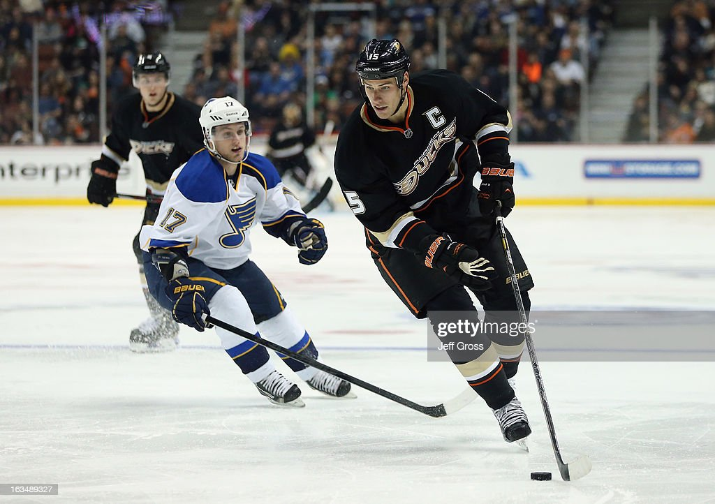 <a gi-track='captionPersonalityLinkClicked' href=/galleries/search?phrase=Ryan+Getzlaf&family=editorial&specificpeople=602655 ng-click='$event.stopPropagation()'>Ryan Getzlaf</a> #15 of the Anaheim Ducks is pursued by <a gi-track='captionPersonalityLinkClicked' href=/galleries/search?phrase=Vladimir+Sobotka&family=editorial&specificpeople=716736 ng-click='$event.stopPropagation()'>Vladimir Sobotka</a> #17 of the St. Louis Blues for the puck in the third period at Honda Center on March 10, 2013 in Anaheim, California. The Ducks defeated the Blues 4-2.