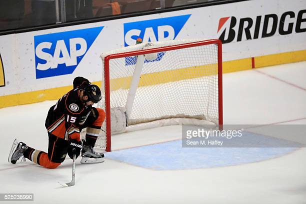 Ryan Getzlaf of the Anaheim Ducks kneels next to the goal after a game against the Nashville Predators of Game Seven of the Western Conference First...