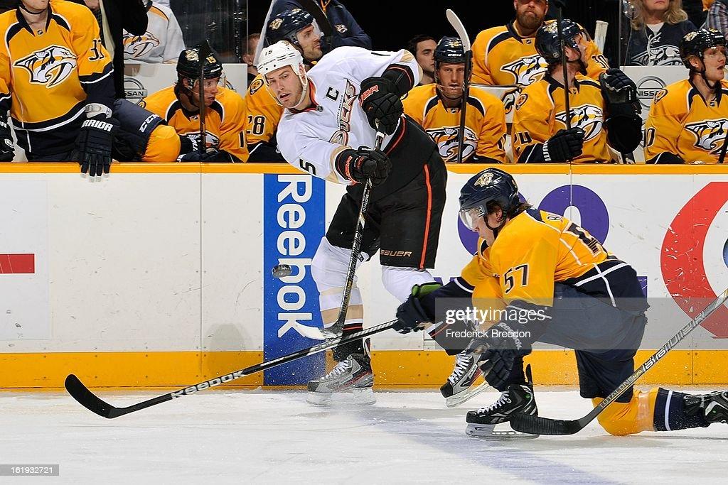 Ryan Getzlaf #15 of the Anaheim Ducks plays against Gabriel Bourque #57 of the Nashville Predators at the Bridgestone Arena on February 16, 2013 in Nashville, Tennessee.