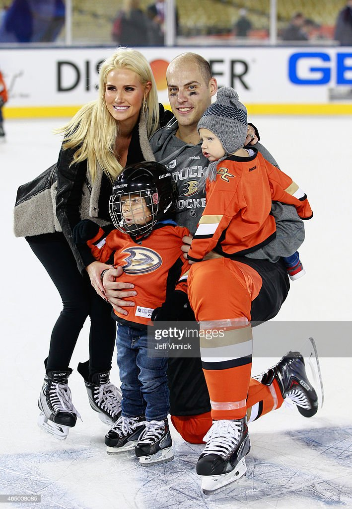 <a gi-track='captionPersonalityLinkClicked' href=/galleries/search?phrase=Ryan+Getzlaf&family=editorial&specificpeople=602655 ng-click='$event.stopPropagation()'>Ryan Getzlaf</a> #15 of the Anaheim Ducks poses with his wife Paige Getzlaf and sons gavin and Ryder during the family skate after the team practice for the 2014 Coors Light NHL Stadium Series against the Los Angeles Kings at Dodger Stadium on January 24, 2014 in Los Angeles, California.