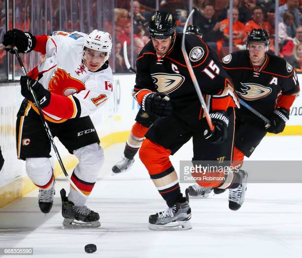 Ryan Getzlaf of the Anaheim Ducks races after the puck against Mikael Backlund of the Calgary Flames in Game One of the Western Conference First...
