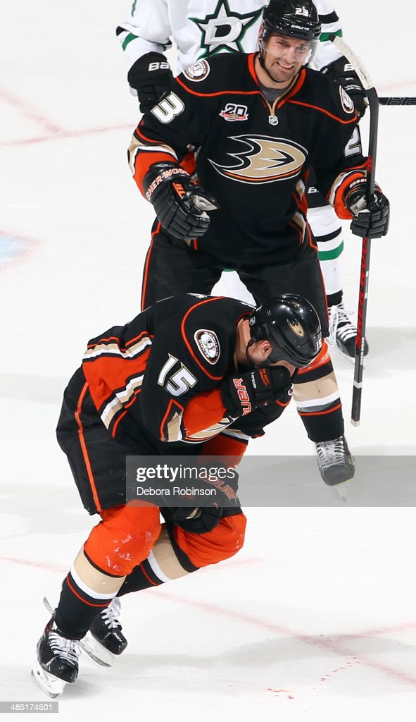 <a gi-track='captionPersonalityLinkClicked' href=/galleries/search?phrase=Ryan+Getzlaf&family=editorial&specificpeople=602655 ng-click='$event.stopPropagation()'>Ryan Getzlaf</a> #15 of the Anaheim Ducks reacts after being hit in the face by a stick as teammate <a gi-track='captionPersonalityLinkClicked' href=/galleries/search?phrase=Francois+Beauchemin&family=editorial&specificpeople=604125 ng-click='$event.stopPropagation()'>Francois Beauchemin</a> #23 looks on during the game against the Dallas Stars in Game One of the First Round of the 2014 Stanley Cup Playoffs at Honda Center on April 16, 2014 in Anaheim, California.