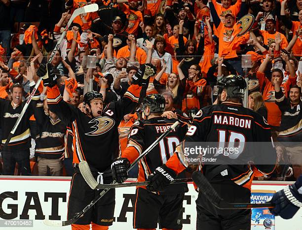 Ryan Getzlaf of the Anaheim Ducks reacts after scoring with teammates Corey Perry and Patrick Maroon against the Winnipeg Jets during the third...
