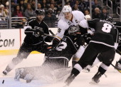 Ryan Getzlaf of the Anaheim Ducks runs into goalie Jonathan Quick of the Los Angeles Kings as the puck goes in the goal at Staples Center on November...