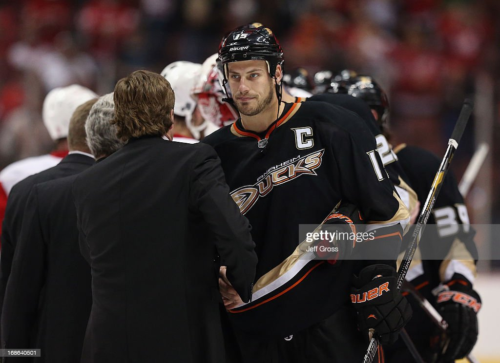 <a gi-track='captionPersonalityLinkClicked' href=/galleries/search?phrase=Ryan+Getzlaf&family=editorial&specificpeople=602655 ng-click='$event.stopPropagation()'>Ryan Getzlaf</a> #15 of the Anaheim Ducks shakes hands with Detroit Red Wings head coach <a gi-track='captionPersonalityLinkClicked' href=/galleries/search?phrase=Mike+Babcock&family=editorial&specificpeople=226668 ng-click='$event.stopPropagation()'>Mike Babcock</a> following Game Seven of the Western Conference Quarterfinals during the 2013 NHL Stanley Cup Playoffs at Honda Center on May 12, 2013 in Anaheim, California. The Red Wings defeated the Ducks 3-2.
