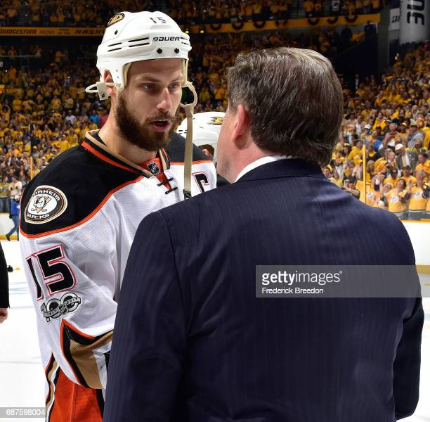 Ryan Getzlaf of the Anaheim Ducks shakes hands with head coach Peter Laviolette of the Nashville Predators after a 63 Predators victory over the...