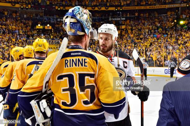 Ryan Getzlaf of the Anaheim Ducks shakes hands with Pekka Rinne of the Nashville Predators after the Predators defeated the Ducks 6 to 3 in Game Six...