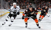 Ryan Getzlaf of the Anaheim Ducks skates against Jeff Carter of the Los Angeles Kings on February 27 2015 at Honda Center in Anaheim California