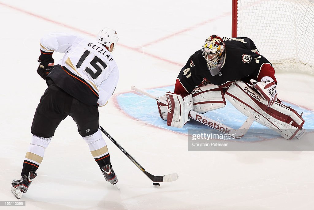 <a gi-track='captionPersonalityLinkClicked' href=/galleries/search?phrase=Ryan+Getzlaf&family=editorial&specificpeople=602655 ng-click='$event.stopPropagation()'>Ryan Getzlaf</a> #15 of the Anaheim Ducks skates in to score a shootout goal against goaltender Mike Smith #41 of the Phoenix Coyotes during the NHL game at Jobing.com Arena on March 4, 2013 in Glendale, Arizona. The Coyotes defeated the Ducks 5-4 in an overtime shootout.