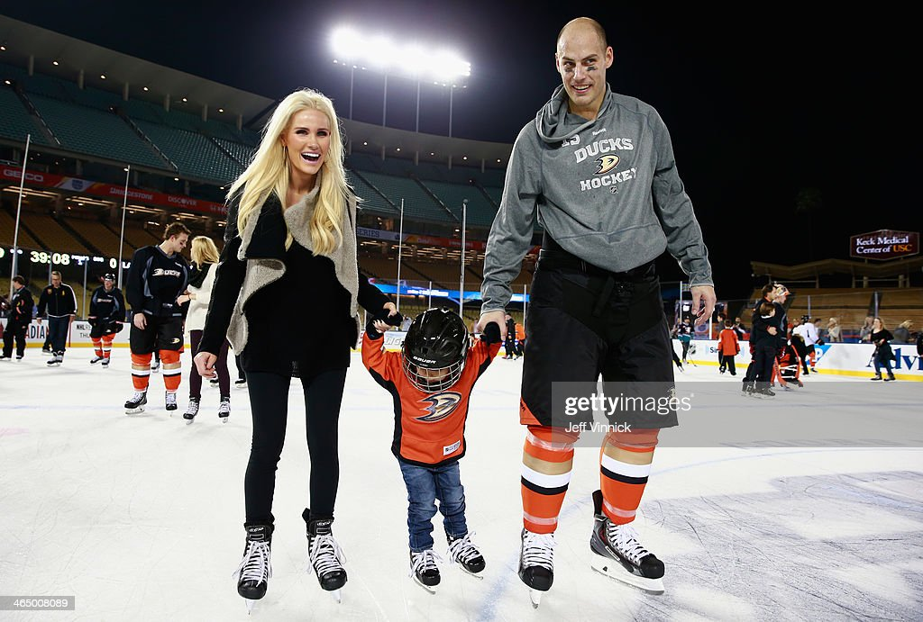 <a gi-track='captionPersonalityLinkClicked' href=/galleries/search?phrase=Ryan+Getzlaf&family=editorial&specificpeople=602655 ng-click='$event.stopPropagation()'>Ryan Getzlaf</a> #15 of the Anaheim Ducks skates with his wife Paige Getzlaf and son Ryder during the family skate after the team practice for the 2014 Coors Light NHL Stadium Series against the Los Angeles Kings at Dodger Stadium on January 24, 2014 in Los Angeles, California.