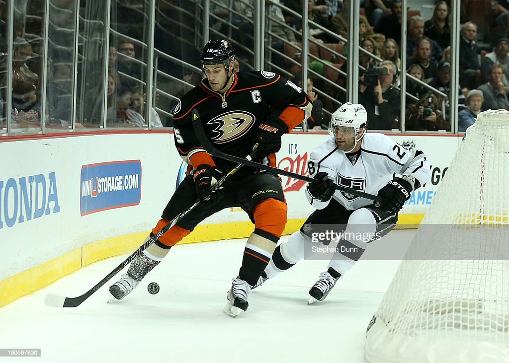 Ryan Getzlaf #15 of the Anaheim Ducks skates with the puck against Jarret Stoll #28 of the Los Angeles Kings at Honda Center on February 2, 2013 in Anaheim, California.