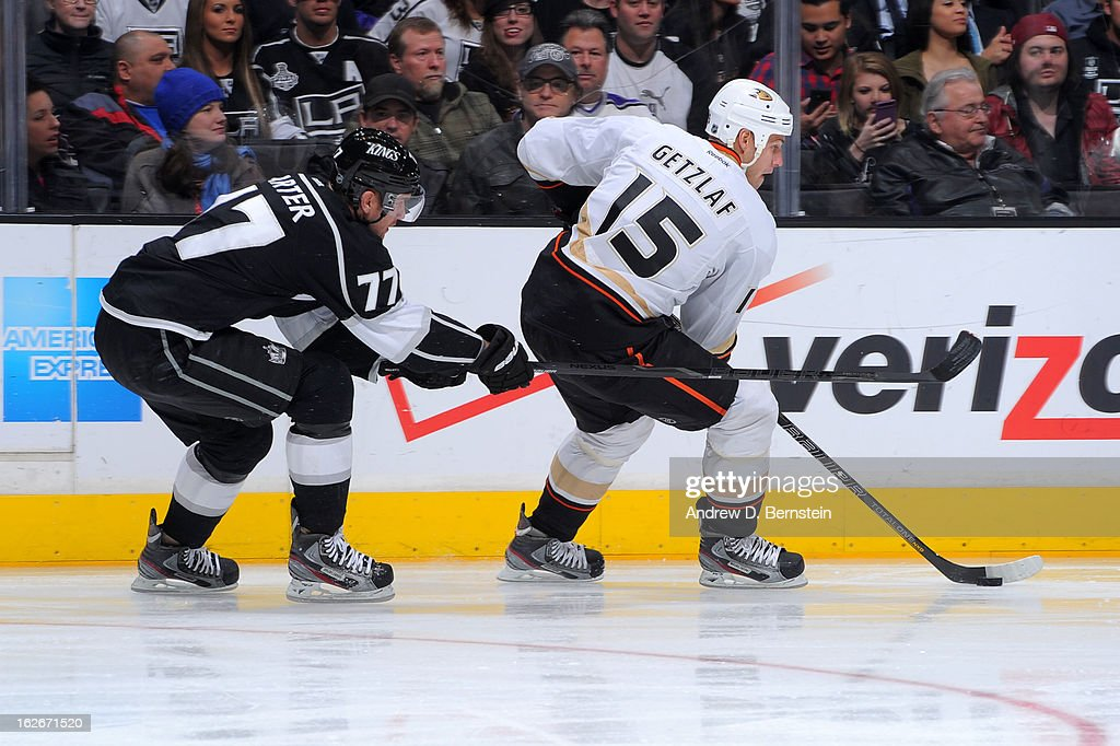 Ryan Getzlaf #15 of the Anaheim Ducks skates with the puck against Jeff Carter #77 of the Los Angeles Kings at Staples Center on February 25, 2013 in Los Angeles, California.