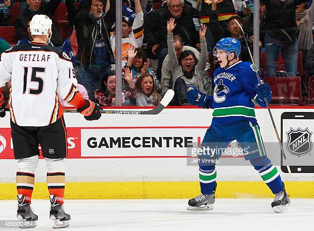 Ryan Getzlaf of the Anaheim Ducks watches as Bo Horvat of the Vancouver Canucks celebrates his first NHL goal during their NHL game at Rogers Arena...