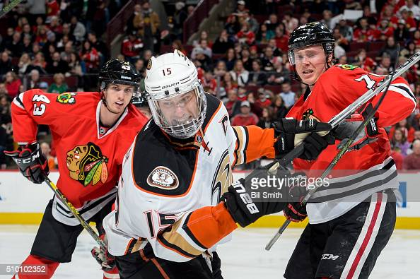 Ryan Getzlaf of the Anaheim Ducks watches for the puck in between Viktor Svedberg and Dennis Rasmussen of the Chicago Blackhawks in the second period...