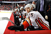 Ryan Getzlaf of the Anaheim Ducks watches from the bench in between shifts against the Calgary Flames at Scotiabank Saddledome on February 20 2015 in...