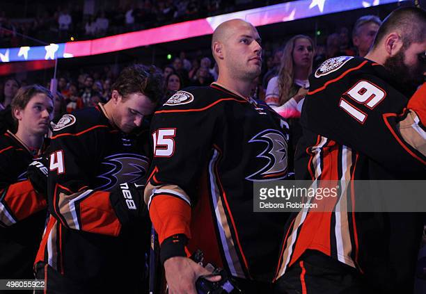 Ryan Getzlaf Patrick Maroon and Cam Fowler of the Anaheim Ducks listen to the national anthem during warmups prior to the game against the Columbus...