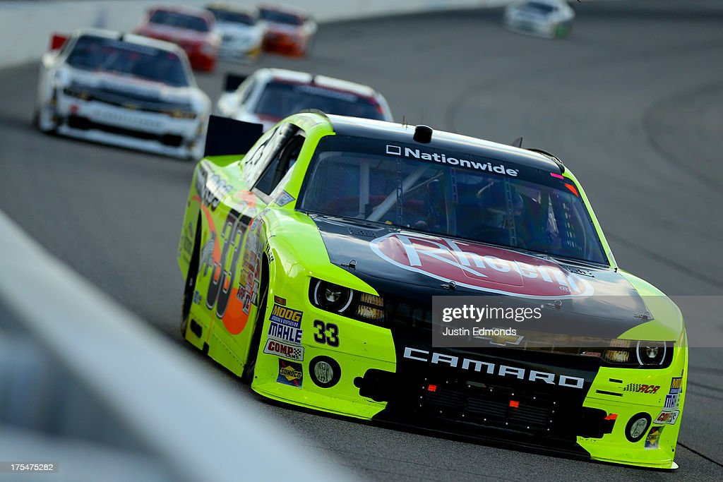 Ryan Gifford, driver of the #33 Menards Chevrolet, leads a pack of cars during the NASCAR Nationwide Series U.S. Cellular 250 Presented by Enlist Weed Control System at Iowa Speedway on August 3, 2013 in Newton, Iowa.