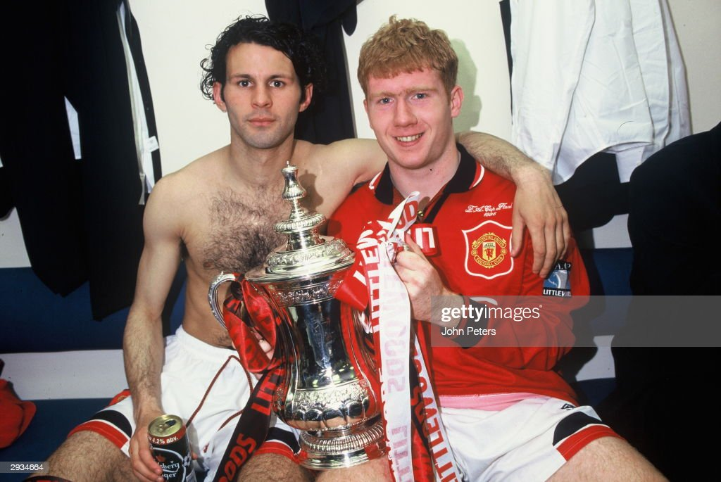 <a gi-track='captionPersonalityLinkClicked' href=/galleries/search?phrase=Ryan+Giggs&family=editorial&specificpeople=201666 ng-click='$event.stopPropagation()'>Ryan Giggs</a> and Paul Scholes of Manchester United celebrate in the dressing room with the FA Cup after the Liverpool v Manchester United FA Cup Final between Liverpool v Manchester United at Wembley Stadium on May 11, 1996 in London. Liverpool 0 Manchester United 1.