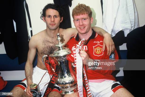 Ryan Giggs and Paul Scholes of Manchester United celebrate in the dressing room with the FA Cup after the Liverpool v Manchester United FA Cup Final...