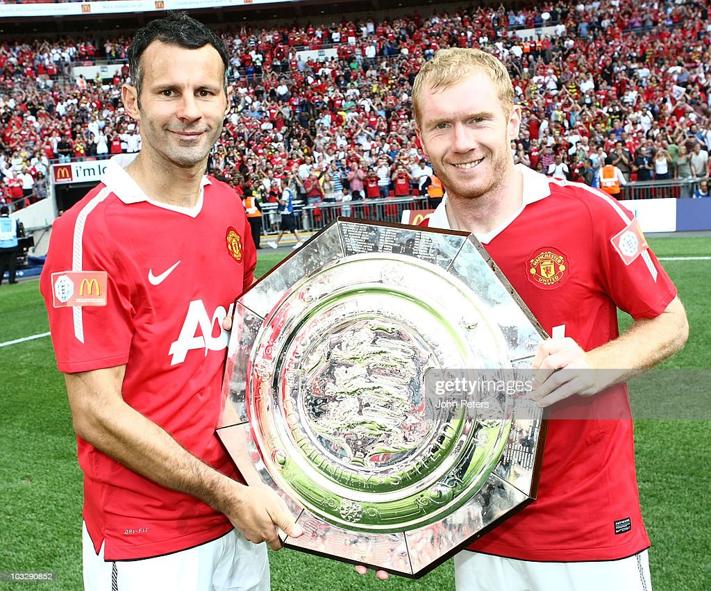 <a gi-track='captionPersonalityLinkClicked' href=/galleries/search?phrase=Ryan+Giggs&family=editorial&specificpeople=201666 ng-click='$event.stopPropagation()'>Ryan Giggs</a> (L) and <a gi-track='captionPersonalityLinkClicked' href=/galleries/search?phrase=Paul+Scholes&family=editorial&specificpeople=171770 ng-click='$event.stopPropagation()'>Paul Scholes</a> of Manchester United pose with the Community Shield after the FA Community Shield match between Chelsea and Manchester United at Wembley Stadium on August 8, 2010 in London, England.