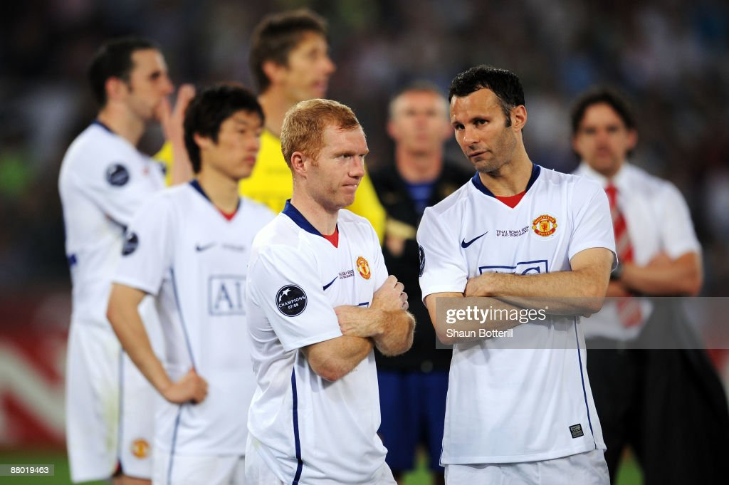 <a gi-track='captionPersonalityLinkClicked' href=/galleries/search?phrase=Ryan+Giggs&family=editorial&specificpeople=201666 ng-click='$event.stopPropagation()'>Ryan Giggs</a> and Paul Scholes of Manchester United react after they lost the UEFA Champions League Final match between Barcelona and Manchester United at the Stadio Olimpico on May 27, 2009 in Rome, Italy.