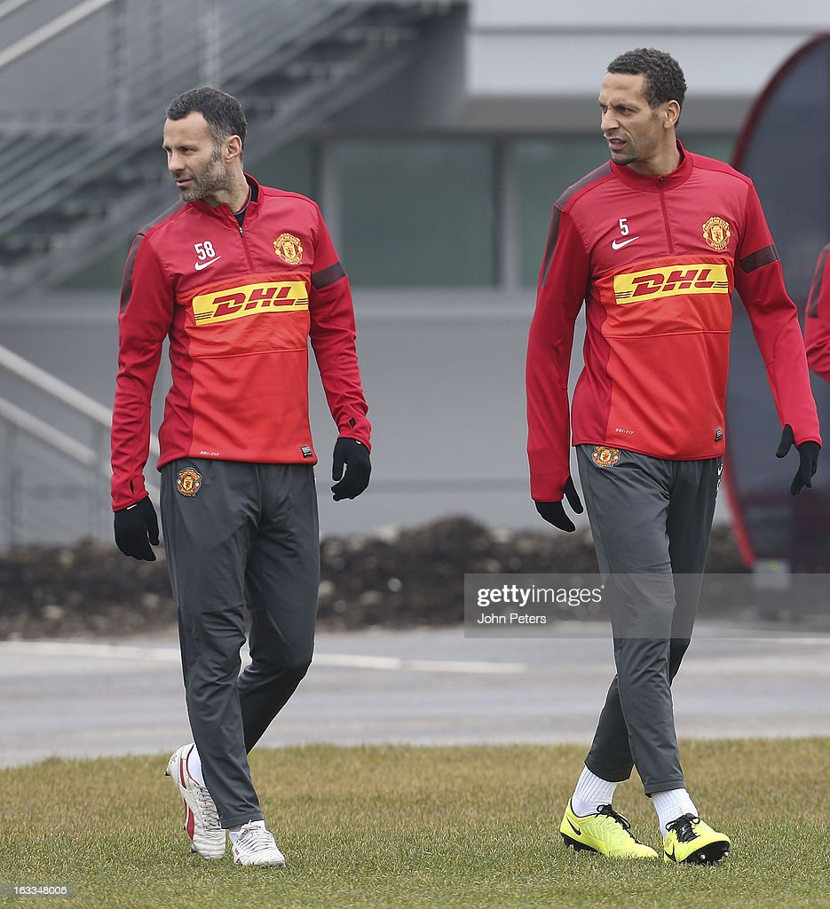 Ryan Giggs (L) and Rio Ferdinand of Manchester United in action during a first team training session at Carrington Training Ground on March 8, 2013 in Manchester, England.