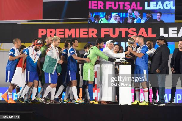 Ryan Giggs and team Mumbai Warriors collect the trophy cup after winning the Premier Futsal League Final vs Delhi Dragons at Al Wasl Sports Club on...