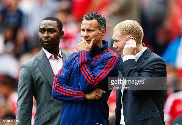 Ryan Giggs coach of Manchester United talks with former Manchester United players Andy Cole and Paul Scholes prior to the Barclays Premier League...